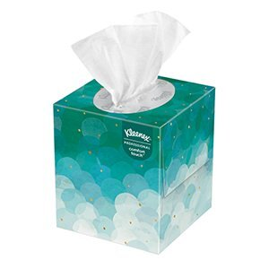 A green decorative box of Kleenex® boutique facial tissues on a white background.