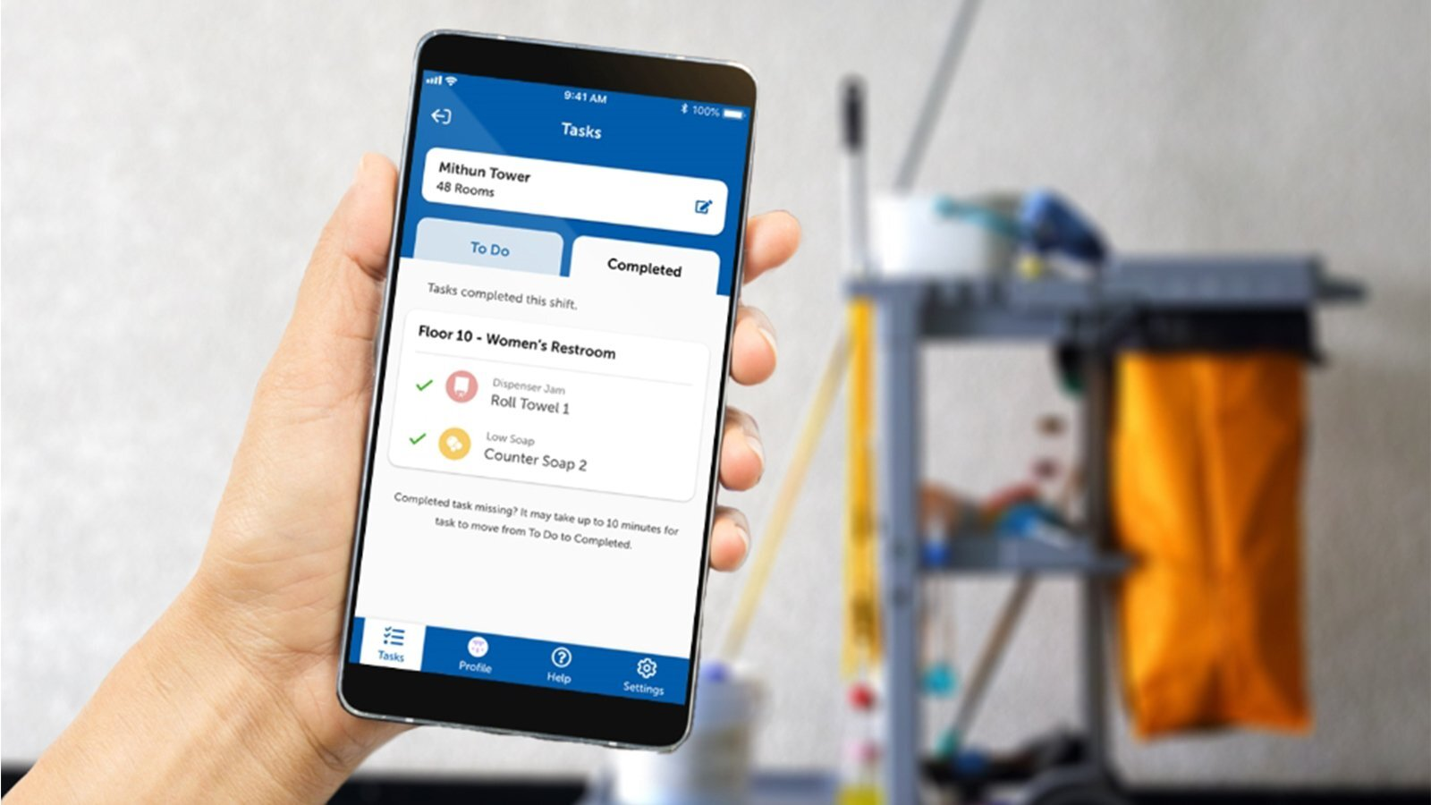 A cell phone displaying the Onvation cleaner app and an image of a facility cleaner.