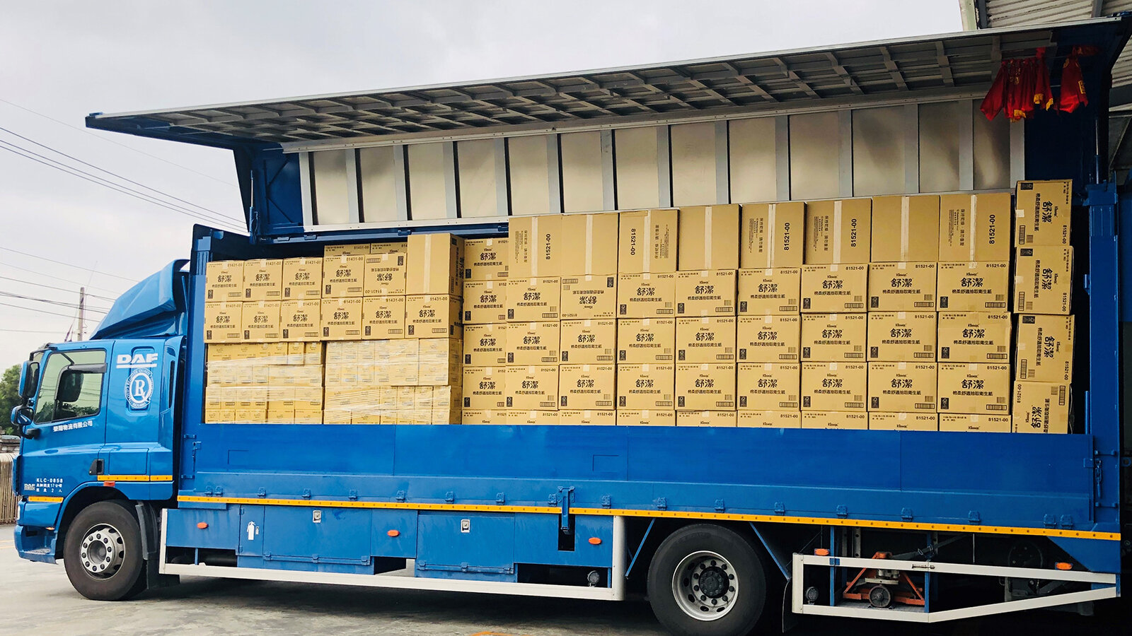 Delivery truck loaded with boxes of rolled paper towels