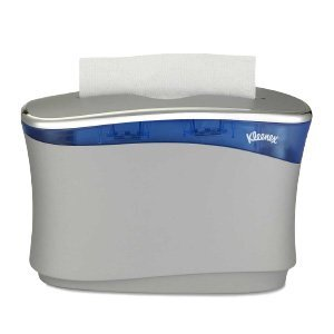A white and blue Kleenex® Reveal™ Countertop tissue dispenser on a white background.