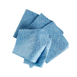 Pile of blue WypAll® oil, grease and ink cloths on white background.